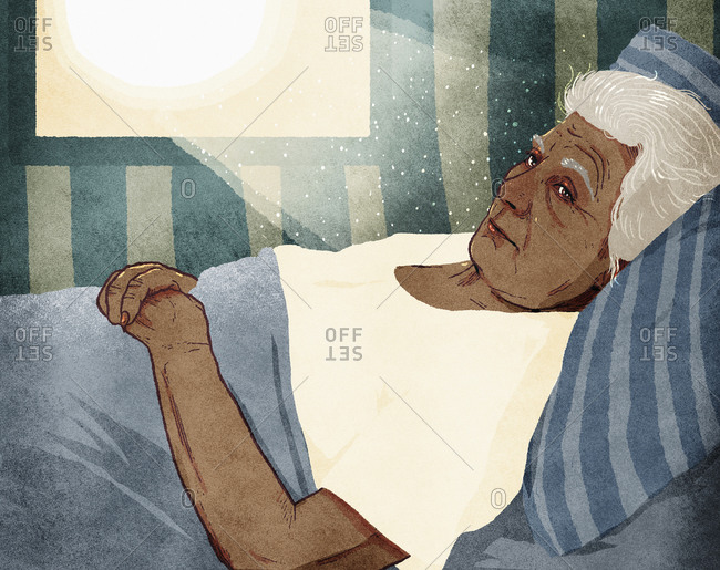 Sun shining on elderly woman lying in bed