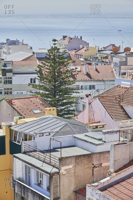 Bird's eye view of Lisbon cityscape with the Tagus river, viewed from Lapa neighborhood, Portugal