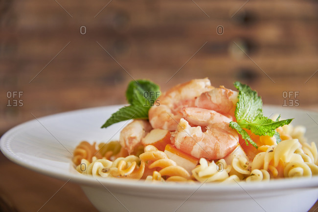 Pasta with shrimp in a white dish