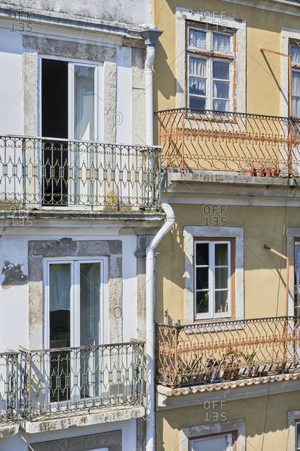 Facade of apartment buildings with balconies in Lisbon, Portugal