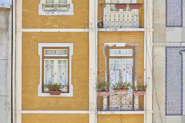 Yellow brick facade of buildings in downtown Lisbon