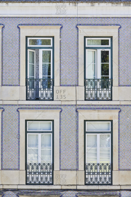 Facade of building with Moorish pattern tile in Lisbon, Portugal