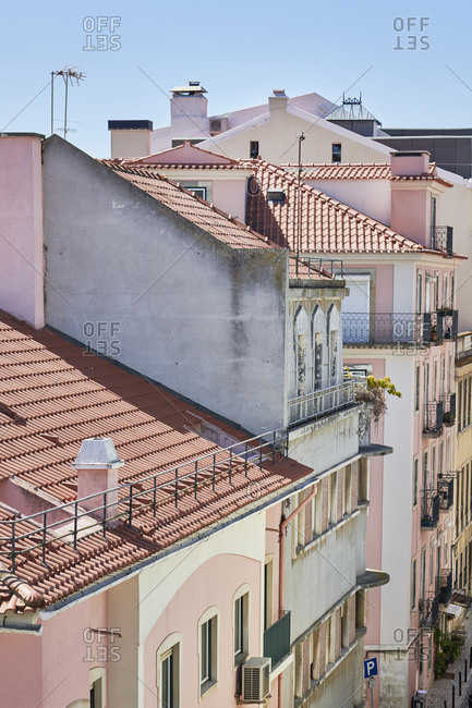 High angle view of pastel facades of buildings and windows, Lisbon, Portugal