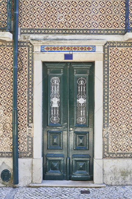 Door surrounded with decorative tile in the Principe Real neighborhood, Lisbon, Portugal