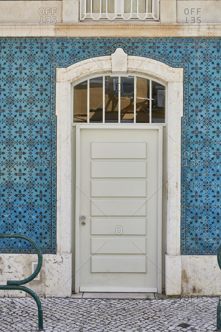 Door surrounded with decorative blue tile in the Principe Real neighborhood, Lisbon, Portugal