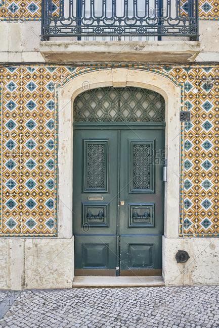 Double door surrounded with decorative tile in the Principe Real neighborhood, Lisbon, Portugal