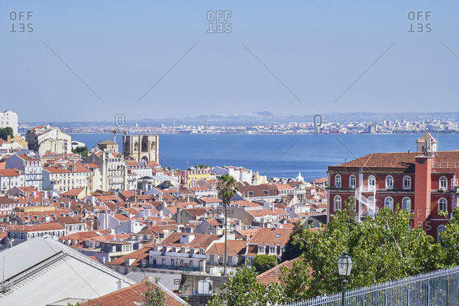 Lisbon cityscape with the Tagus river, viewed from Miradouro de Saeo Pedro de Alcantara, Portugal