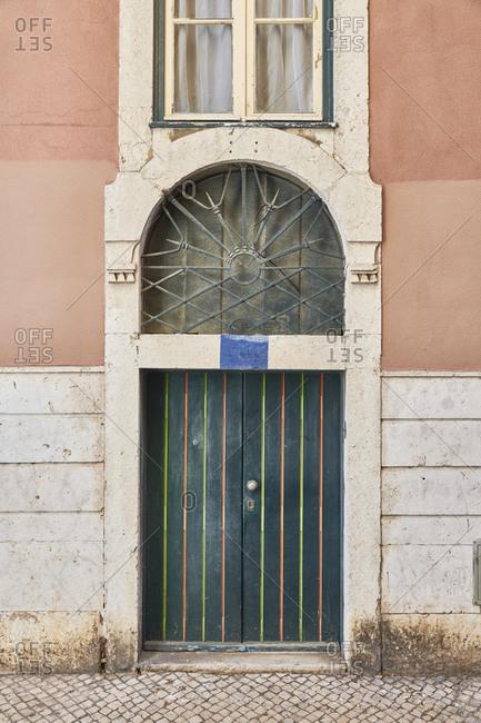 Green door on pink home in the Santa Catarina neighborhood, Lisbon, Portugal