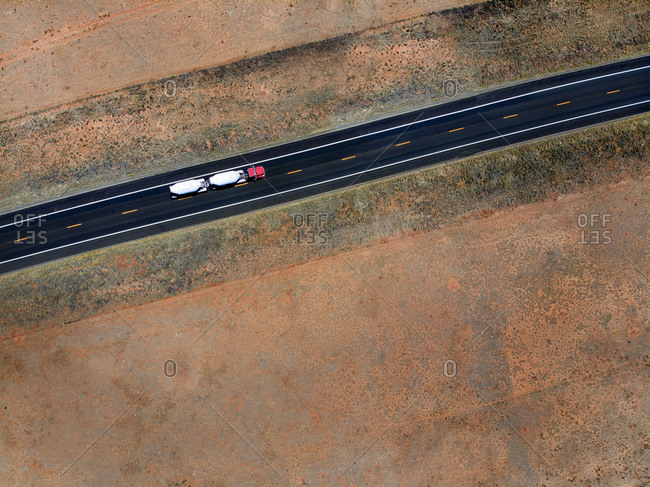 Transport truck seen from drone above desert roadway in Southern Utah, USA