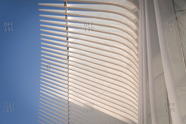 March 3, 2020: From below exterior of Oculus building in New York city with steel ribs and unusual design against clear blue sky in sunny day