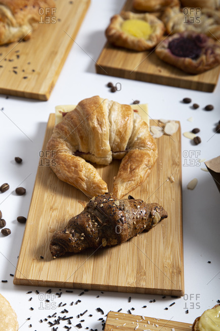 Close-up of still-life breakfast table with assorted croissants and coffee beans