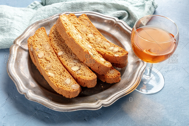 Biscotti, traditional Italian almond biscuits, with a glass of vin santo sweet wine