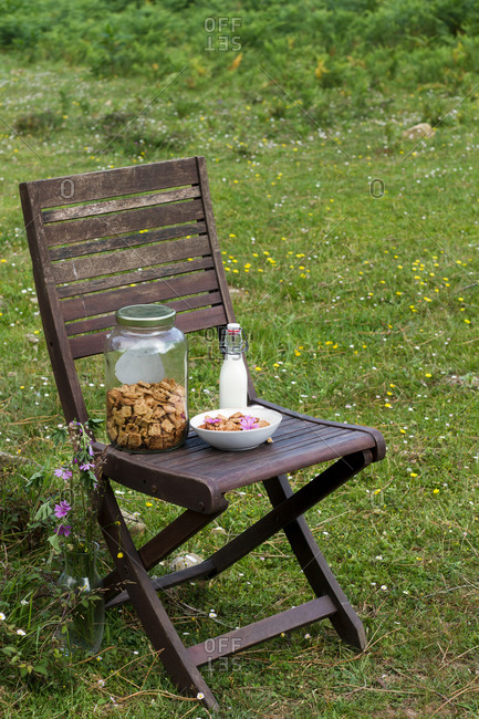 Cinnamon cereal and milk on wooden chair