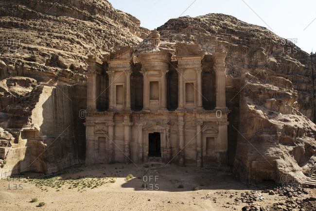 Amazing view of facade of stone historic monastery with ornamental entrance located in Jordan