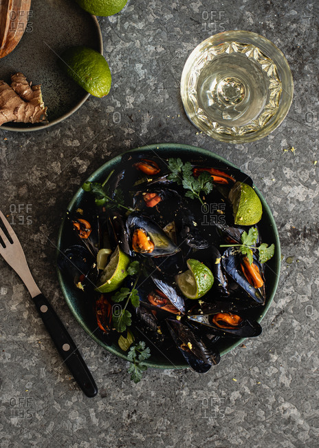 Steamed mussels in bowl on the table