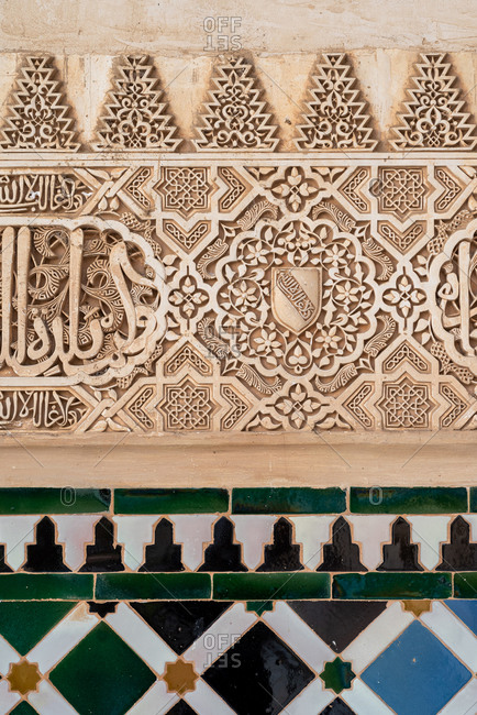Granada, Spain - January 0, 1900: Ancient arabic ornaments on the wall of Alhambra, Granada, Spain