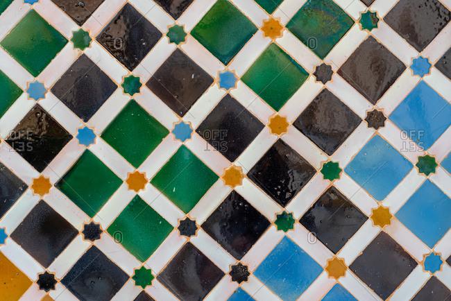 Granada, Spain - January 0, 1900: Wall tiles design at Alhambra, Spain