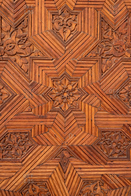 Granada, Spain - January 0, 1900: Detail of a carved wooden door in the Alhambra, Granada, Spain
