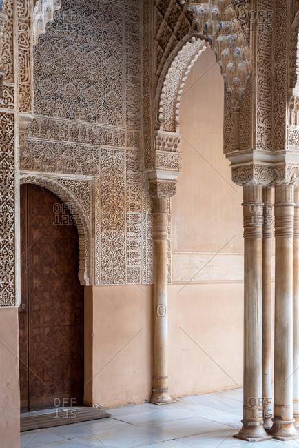Granada, Spain - January 0, 1900: Moorish arches in the Court of the Lions in The Alhambra, Granada, Spain