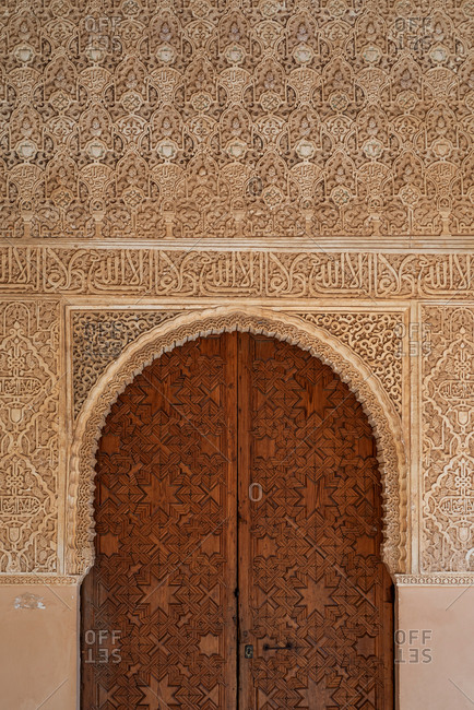 Granada, Spain - January 0, 1900: Moorish door in the Court of the Lions in The Alhambra, Granada, Spain