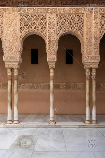 Granada, Spain - January 0, 1900: Moorish arches in the Court of the Lions in The Alhambra. Granada, Spain