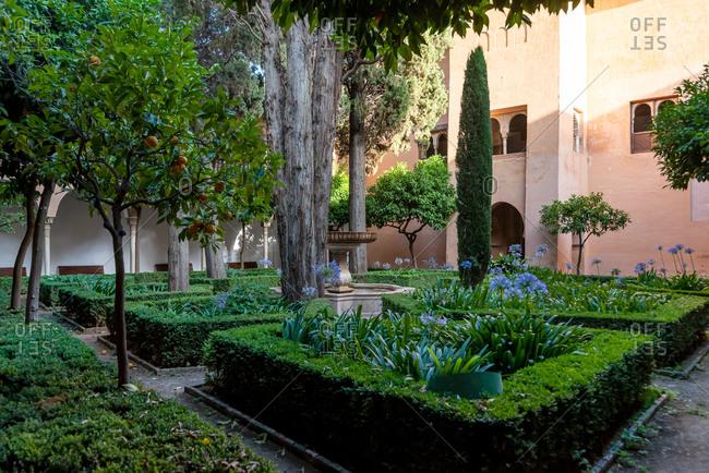 Granada, Spain - January 0, 1900: Alhambra gardens in Granada, Spain