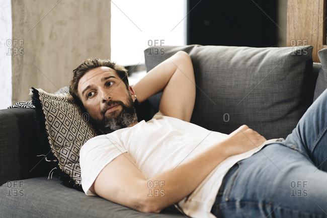 Mature man lying on couch- relaxing