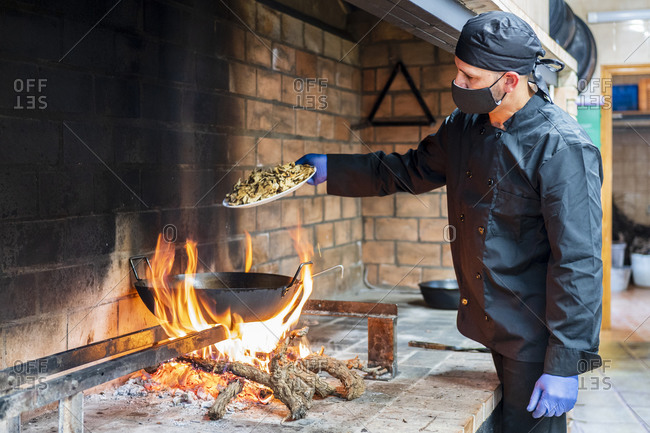 Traditional cooking of Spanish food in restaurant kitchen