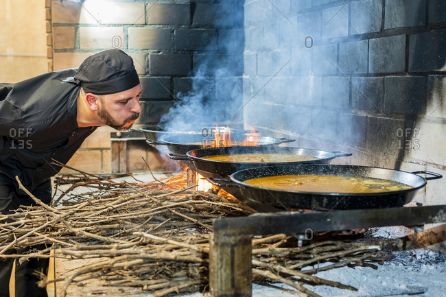 Traditional cooking of paella in restaurant kitchen