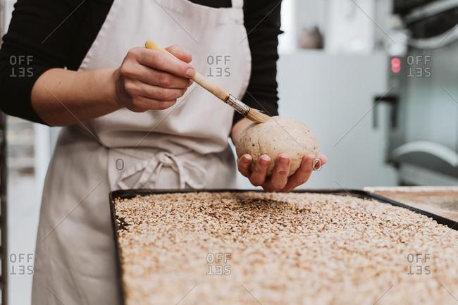 Baker preparing wholegrain buns at bakery