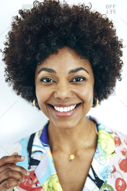 Happy woman with afro hairstyle against white background