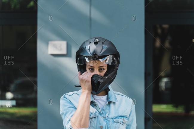 Woman with black motorcycle helmet