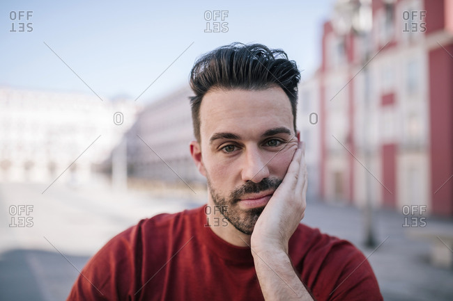 Close-up of bored man with hand on face