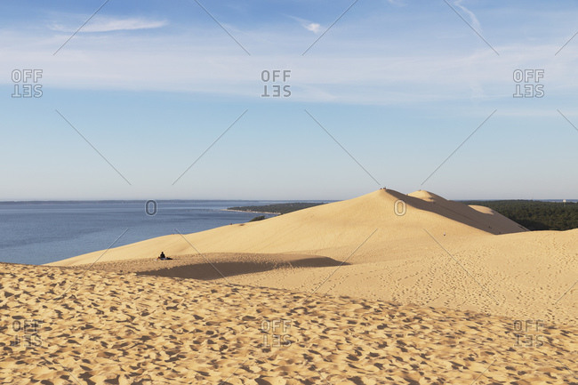 Idyllic view of sand dunes and Atlantic ocean against sky- Nouvelle-Aquitaine- France