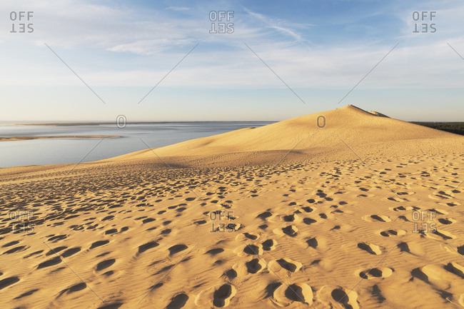 Idyllic view of Pilat dunes against sky during sunset- Nouvelle-Aquitaine- France