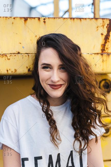 Beautiful young woman smiling on metallic platform