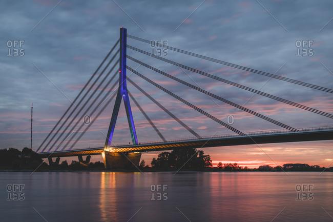 Germany- North Rhine-Westphalia- Wesel- Niederrheinbrucke Wesel bridge at cloudy sunset
