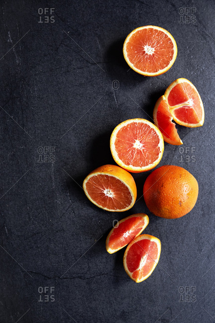 Fresh blood oranges cut in segments and halved