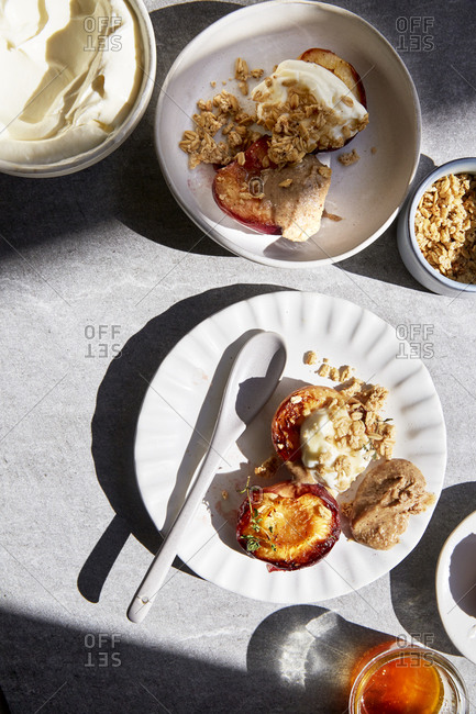 Roasted and grilled nectarines with thyme, honey, yoghurt, nut butter and granola