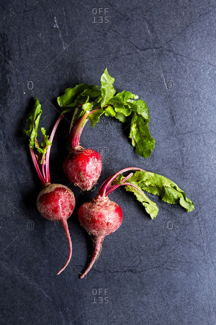 A bunch of beetroot on a moody background