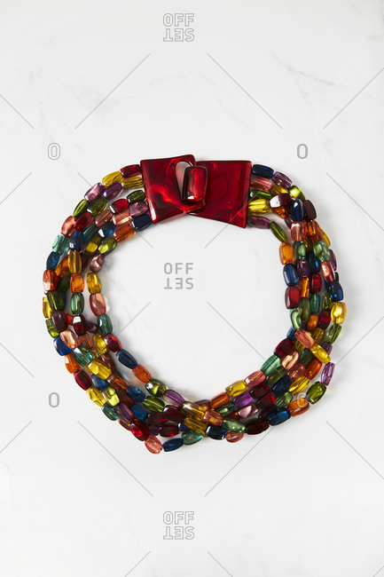 Multicolored beaded necklace with a red acrylic clasp necklace