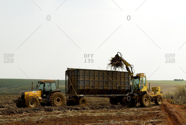 Brazil - September 21, 2007: Farmers using tractors and equipment to clear fields