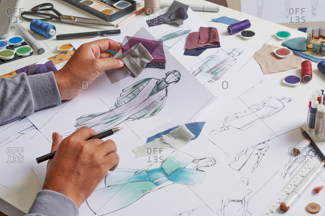 Fashion designer sketching costume design