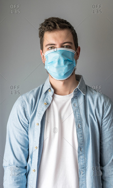 Man looking at camera wearing a mask for to prevent virus infection