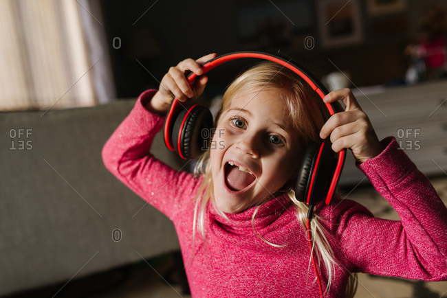 Little girl singing with headphones on