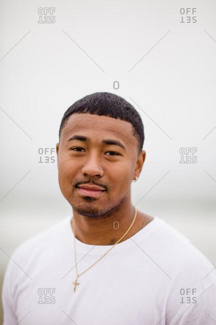 Mixed race man posing at beach