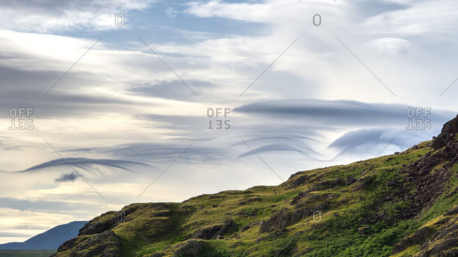 Part of the langdales gives the backdrop to cloud formations during sunset in the english lake district