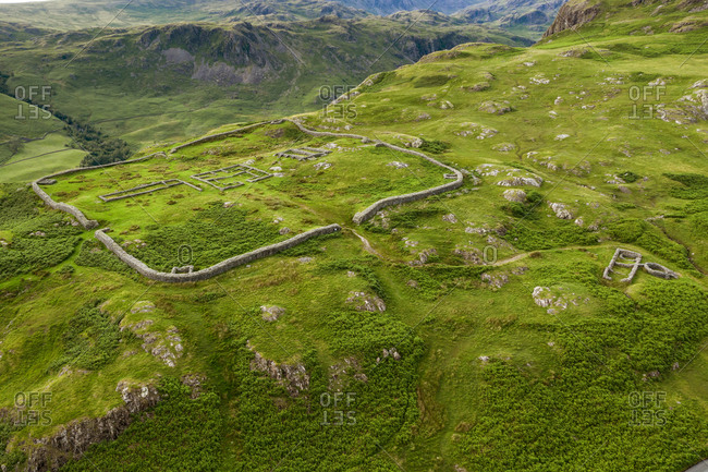 Aerial of hard knott roman fort is an archeological site, the remains of the roman fort mediobogdum, located on the western side of the hard knott pass in the english county of cumbria