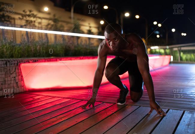 Black runner in crouch start position