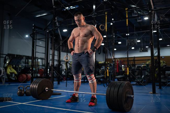Muscular bodybuilder preparing for exercise